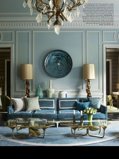 Perfect blues!! And that sofa.... Such a chic but livable room!