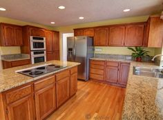 ForSale Gourmet Kitchen With Oak Cabinets Slab Granite High End Appliances