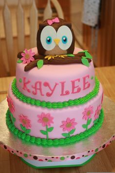 Pink Owl Cake - This cake was for a 1st birthday. This cake is covered with MMF with MMF and buttercream accents.  The owl is RKT with MMF/gumpaste accents.
