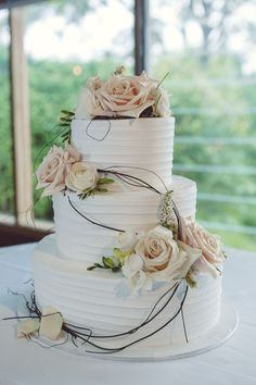 wedding cake, 3 tier, white icing, peach and white flowers, vine, roses, spring…
