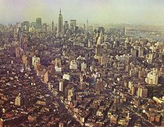 Aerial view of Greenwich Village looking northeast showing Midtown Manhattan skyline. October 1965.