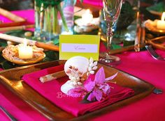 Luau theme - exotic tablescape with shell elements, wooden plates, tropical flowers and leaves