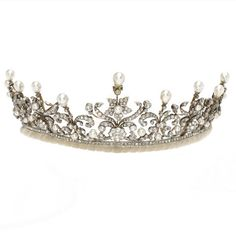 A simulated pearl and paste tiara, (illustrated above)