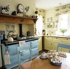 La vieille cuisinière et les couleurs de cette cuisine! <3.