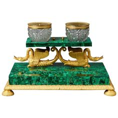 Early 19th Century Russian Empire Malachite and Ormolu Inkstand Encrier Swans -  Of rectangular form with an acanthus leave decorated border on round feet. Two swans are supporting the cut glass bottles.