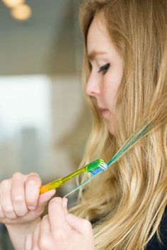Use an old toothbrush to apply liquid hair chalk or highlights.