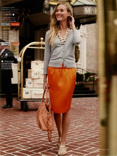 Grey cardigan, colorful skirt, statement necklace.