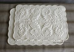 gorgeous wholecloth trapunto quilted placemats, by natalya crane, from the guravlik blog