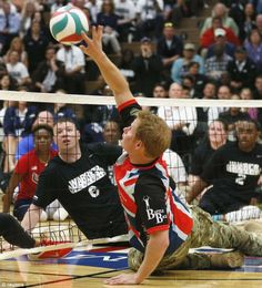 Having a ball: Prince Harry plays volleyball at the opening of the Warrior Games in Colorado Springs