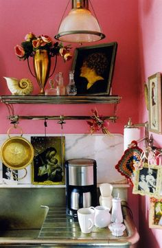 Pink walls make the vintage finds in this kitchen stand out.