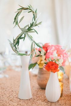 "Instead of treating table numbers as an afterthought, incorporate them into the tablescape. Says Carissa Jones of JL Designs, ""We worked with Jesi Haack to bend thick wire into numbers, then added sprigs of olive branches so that the numbers blended into the reception décor."" Related: 5 Creative Ideas for Your Table Numbers"