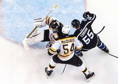 Body save:   Goalie Jonas Gustavsson of the Boston Bruins makes a save against Braydon Coburn of the Tampa Bay Lightning at the Amalie Arena on Oct. 31 in Tampa, Florida. - © Scott Audette/NHLI/Getty Images