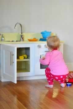 Wonderful DIY for a super cute and sturdy play kitchen....starts out with an over the fridge or micro cabinet raised up with a 1x4 board, stainless steel bowl for sink and an oven rack. Check out the blog for all the cute details and how to....Clara's Christmas Kitchen!