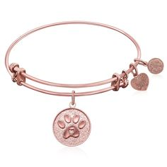 An expandable bangle in pink tone brass. A symbol representing man's best friend. The dog uses his paws to shake 'hands', get our attention, and run to us with a big grin on his face. Specification -