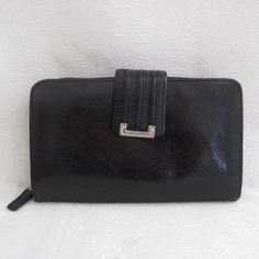 "Black Genuine Leather Zip Around Wallet Genuine Leather Black Zip Around Wallet. Pre-owned in good condition. Has MINOR CRACKS on the corners but not visible. Please see pictures carefully before buying. You will get exactly as pictured. Photos shown are the closest true color. Sold as is! Dimensions: 4""H x 7""W x 1""D ~❌SWAP❌TRADE ~ ✔️❤️Bundles ~✔️Smoke-free/pet-free home Bags Wallets"