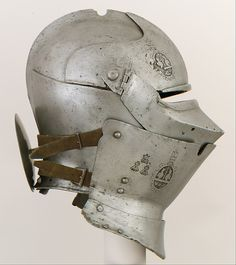 Armet with Wrapper Date: armet, ca. 1460–70; wrapper, ca. 1450; rondel, probably 18th–19th century Culture: Italian Medium: Steel, leather.