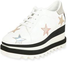 """Stella McCartney Elyse Stars Platform Sneaker.  Stella McCartney """"Elyse"""" sneaker in faux-leather (polyester/polyurethane). Colorblock metallic star trim. 3.2"""" striped wedge heel; 1"""" platform; 2.2"""" equiv. Square toe. Lace-up vamp. Perforated suede logo at backstay. Grosgrain striping at heel counter. Padded footbed. Rubber outsole. ~affiliate link"""
