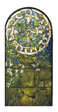 TIFFANY STUDIOS A Leaded Glass Window, circa 1910 65¼ x 31 in. (165.7 x 78.7 cm.)