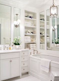 So much storage!  Beautiful White Bathroom with lots of storage both with cabinets, drawers & open shelving.