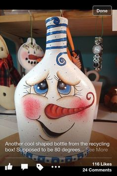 I luuv this fatty rosy cheeked wanna give him a squeeze snow- -guy!Like this face, bottle of wine, soda or Apple cider even a good size honey jarTurn your own side counter bulb applying an upcycled lilac bottle.Continue to make your own part tables d Glass Bottle Crafts, Wine Bottle Art, Painted Wine Bottles, Decorated Bottles, Vodka Bottle, Liquor Bottles, Glass Bottles, Snowman Crafts, Holiday Crafts