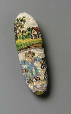 Miniature eyeglasses and beaded case, made in France in the late 18th century (source).