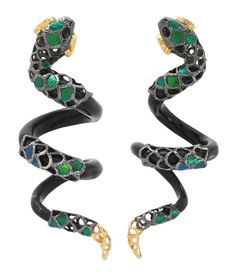 These earrings are made of polished black wood, featuring carved Sterling silver head and tail decorated with 18K gold with scarab pieces, and emerald in the eyes. Dimension: 6.7x2.3x2.7 cms.