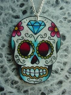vintage tattoo style dia de los muertos (day of the dead) sugar skull with flowers and diamond necklace. $22.00, via Etsy.