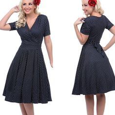 """50's Swing Polka Dot Wrap Dress Crafted from an exceptionally soft quality stretch blend, this stupendous swing blends all the right 50's sensibilities. A v-neck cross over bodice is met with ruched short sleeves and ties securely at the back of the waist. A thick band cinches comfortably at the natural waist while the A-line swing skirt flows to the knees in pleated perfection. 41"""" bust, 33"""" waist, Free hips, 45"""" long. Best fit 14/16. Model is wearing a crinoline under her dress. Unique…"""