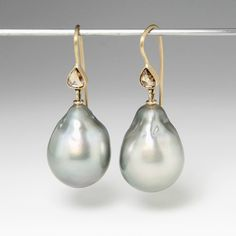 "Go ahead and be the ""Girl with a Pearl Earring"" with this pair of 18k yellow gold Gabriella Kiss earrings! They are beautifully paired with lustrous grey baroque Tahitian pearls topped with bezel set chocolate-brown pear shaped rose cut diamonds totaling 0.50cts."