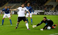 Gianluigi Donnarumma (R), goalkeeper of Italy saves the shot of kevin Volland of Germany during the International Friendly Match between Italy and Germany at Giuseppe Meazza Stadium on November 15, 2016 in Milan, Italy.