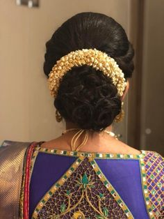 What a beautiful large low bun with flower gajra! Care however should be taken before adopting such hairstyles, as due to it's high static charge, it will cause phlegm to move up in the throat, causing the voice to quaver & a frequent urge to clear the throat. A heavy chabi chhalla with a long & wide hook if inserted at the edge of the pleats of the saree, will reduce this problem as it's hook will activate the acupressure points that act to keep the throat clear.