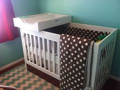 My husband made this crib changing station to fit on top of our crib since our nursery is small. It is awesome, the perfect height for changes and even has built in storage.