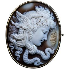 Antique Italian Carved Shell Cameo Medusa Gorgon Brooch | From a unique collection of vintage brooches at https://www.1stdibs.com/jewelry/brooches/brooches/