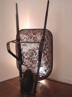 """Cal Lane - an artist who takes the raw ruggedness of steel and iron and the delicateness and sensitivity of lace, combining a male material with a feminine one, to create very provocative and seductive sculptures. She calls her pieces """"industrial doilies."""""""