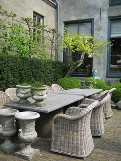 I love pairing these wicker chairs with a stone or zinc top table