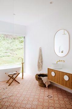 Three Birds Renovations House 10 Main Bathroom. Pink Tiles, Gold Tapware, Freestanding Bath, Rendered Bathroom