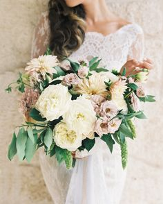 Renee's bouquet was composed of garden and spray roses, café au lait dahlias, scabiosas, clematis, veronicas, millet, and bay leaves.