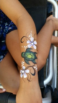 Hawaiian turtle and flower face paint by artist Sarah Pearce with Earth Fairy Entertainment