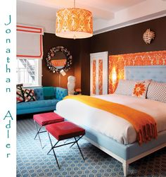 Blue and orange.... I love some of the orange pieces..., like the lighting fixture.... The window covering....& the fabric wall covering & the orange throw on the foot of the bed... Would look amazing w/grey, white, black.... And bright blue... Thatz my vision .... For now .... Unless it changes... Lol