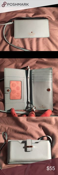 Kate Spade ♠️ light blue smart phone wallet Beautiful light blue color, has a long strap so can be worn as a crossbody, has multiple slots for cards. Used only a couple times, like new, just a few barely noticeable scratches on hardware. Fits an iPhone 6/6s. kate spade Bags Wallets