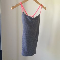 Lululemon tank, grey with pink grapefruit straps Lululemon athletica yoga tank, light marled grey with pink grapefruit straps. Size 4. Has built-in shelf bra with removable cups. Longer length. Form fitting. Super soft luon material. lululemon athletica Tops Tank Tops