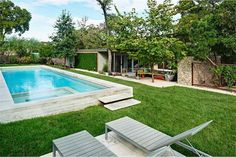 Custom pool & spa and extensive landscaping create an organic resort-like feel experience on the home's generous sized lot 2604 Pecos St, Austin, TX 78703