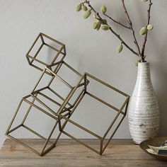 Contemporary art on a small scale. Decorate a shelf, table or mantel with this Cubed Sculpture, made of iron in an antique bronze finish.