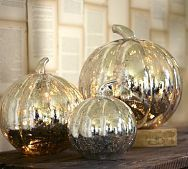 Spray old cheap Pumpkins. with krylon looking glass paint.. I actually have some I could do this too.. Yippee! halloween