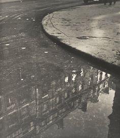 Ilse Bing, Puddle of Water, Rue de Vaugirard, Paris, 1952; photograph; gelatin silver print