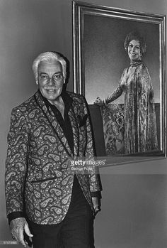 Hollywood film and TV actor Cesar Romero poses in the foyer of his home in Beverly Hills, California. Romero was perhaps best known for his role as 'The Joker' in the Batman TV series.
