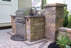 outdoor kitchen. I like how contained this is. It doesn't take up the whole patio but it's built in.