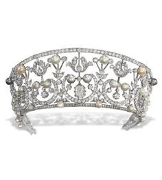 A BELLE EPOQUE TIARA. Of kokoshnik design, the old-cut diamond foliate openwork band interspersed with button-shaped cultured pearls and pearls of varying hues, the centre set with a cushion-shaped diamond, adapted, circa 1905. #BelleÉpoque #tiara