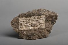 Plymouth Rock fragment with painted inscription, 1830. In the early 1800s, tourists visiting Plymouth Rock were provided a hammer so that they could take a piece of the rock as a souvenir. By 1880, what was left of the rock was fenced off within a memorial.
