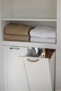 IMG_0031 by amyalday, via Flickr Brilliant! The bathroom laundry disappears into the laundry room! LOVE.
